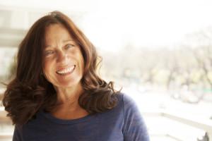 mature woman using hyaluronic acid serum - anti-aging skincare routines
